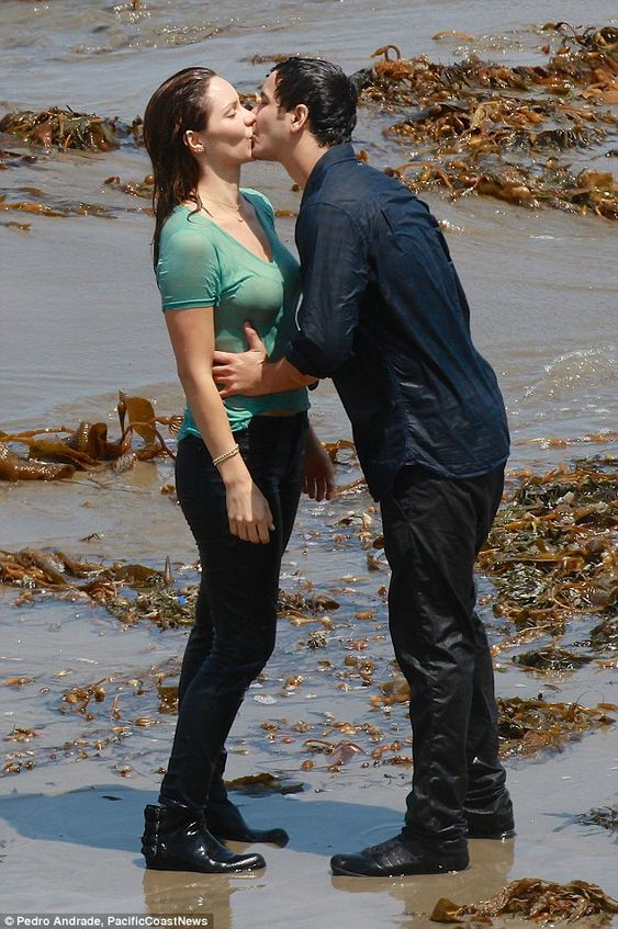 Snogging on the sand: Katharine McPhee and Elyes Gabel made the most of a filming break in...