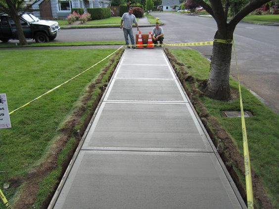 How to pour a concrete sidewalk garden ideas walkways for What temperature to pour concrete outside