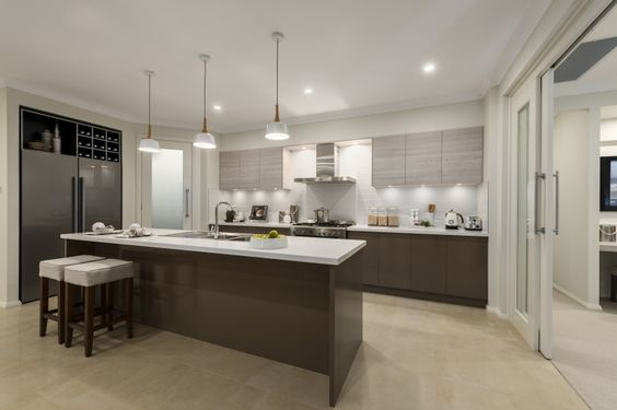 Coastal inspired kitchen in our Havana Executive on display in Homeworld Thornton. For details see http://mcdonaldjoneshomes.com.au/display-home-locations/hunter-home-world-2 #coastal #beach #beachy #style #beachstyle #coastalstyle #islandbench #pendant #pendants #cabinets #fridge #stools #neutral #palette #interiordesign #display #newhome #décor #homedecor #colours