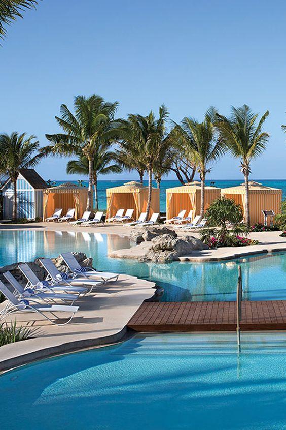 Beautiful palm fringed trees line the pool at Grand Hyatt Baha Mar, Bahamas