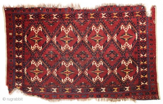 antique ersrai chuval with ikat type design and an unusual bit of silk pile. All natural colors including magenta and green silk knots. Overall low pile with wear and edge roughness as  ...