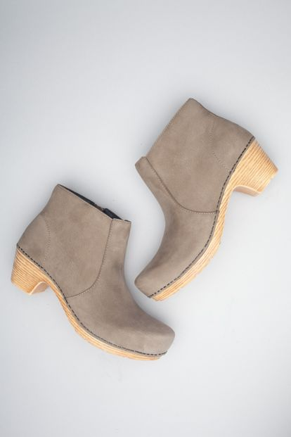 Maria, a contemporary ankle boot, features optimal arch support, a long-wearing PU bottom and a roomy, softly rounded toe box.