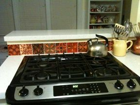 This is a creative way to use a backsplash tile set, this one the Mosaic Tuscan Set of nine tiles.
