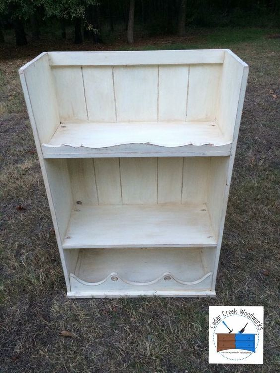 Vintage hutch painted and turned upside down to use as a display piece