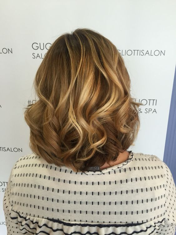 Dark roots with blonde chunk highlights.