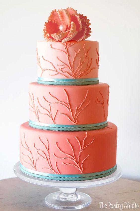 Coral and aqua wedding cake