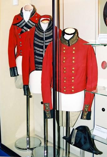 A set of Coatees and Infantry officer's hat as used by the 96th Regiment. From left to right they date from 1796-1816, a short-...