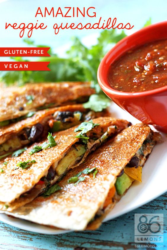 Amazing Veggie Quesadillas // avocado, coconut oil, cumin, daiya cheese, dried oregano, fresh coriander, fresh spinach, green bell pepper, ground coriander, jalapeno, lime, mushrooms, red bell pepper, red onion, salsa, tinned black beans, tortillas