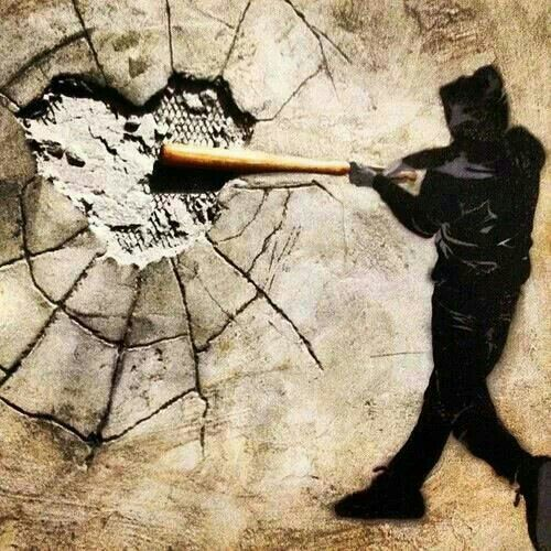 Smashing walls and smashing hearts. Banksy Street Art.: