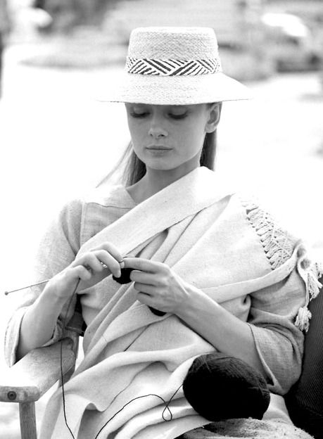 Audrey Hepburn, knitting on the set of The Unforgiven (1960). Hepburn was indeed a real-life knitter, and worked on sweaters for both her and her husband during breaks in filming the movie.