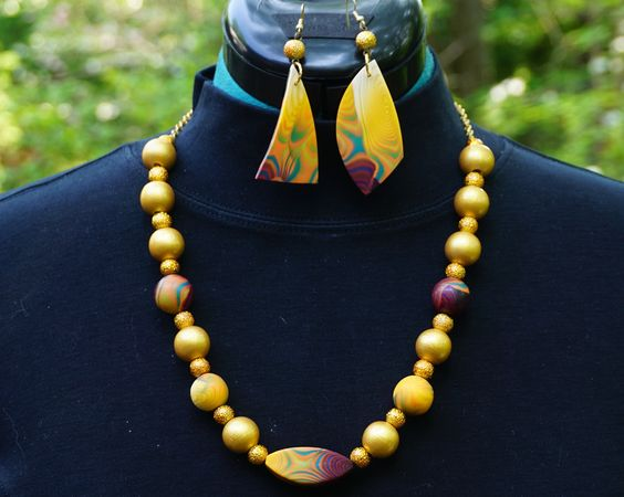 """""""Casablanca Sunset"""" necklace and earrings.  Polymer clay and glass beads."""