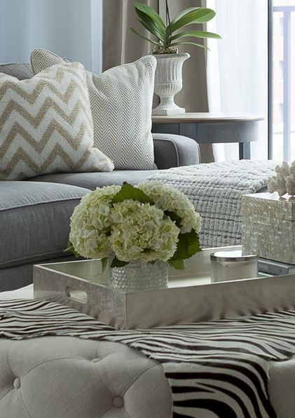 The Elegant Abode: Chic, contemporary living room with gray linen sofa paired with white and gold chevron ...