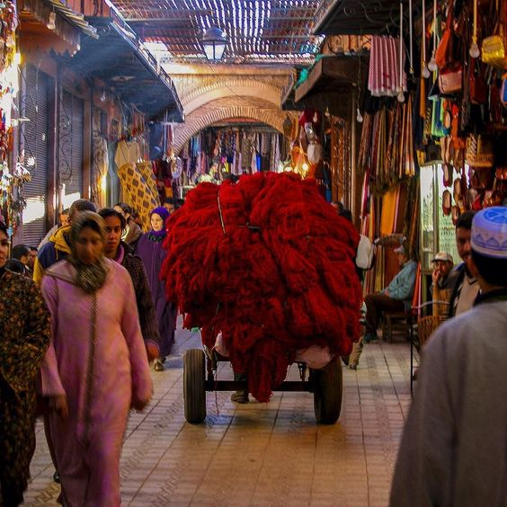 Photo by @andywcoleman // The souks of Marrakech are a seemingly infinite maze of shops selling everything you can imagine. It is both chaotic and organized - bursting with energy and colors. I tried to keep up with the man pulling this massive cart of yarn but he swiftly moved through the narrow corridors and disappeared into the crowd. by natgeotravel