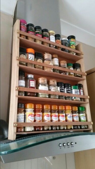 Home made spice rack. Oak and mahogany.  Because it's on the cooker hood it's a heightest.