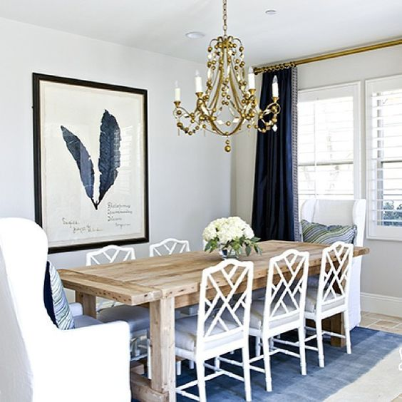 natural wood table with white painted chairs