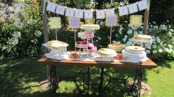 """Pie display on old sewing machine tables...really cute stands and a sign """"sweet as pie""""  super cute"""