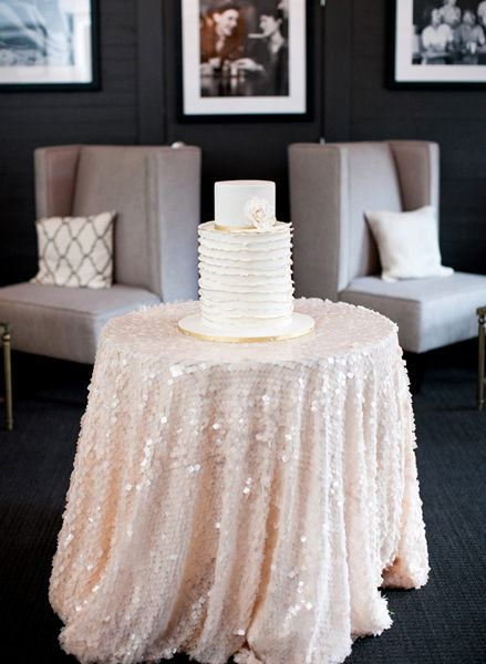 Romantic pink sequin tablecloth for the cake table! Photo: Josh Gruetzmacher