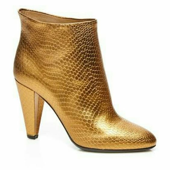 "Jill Stuart Gold Booties NWT size 7.5 Never work. Gold booties. Jill Stuart.  Leather ankle boot Pointed toe Stacked heel Slip-on style  Material:?Leather/Haircalf (cow) upper, Leather lining and sole Approx. measurements:?Heel 3.5"", Shaft 4"", Circumference 11"" Origin:?Made in Italy Fit:?This style fits true to size Jill Stuart Shoes Ankle Boots & Booties"