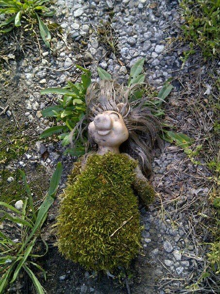 themarysue:  prettyarbitrary:  malformalady:  Abandoned Miss Piggy covered in moss  I feel strangely like I'm looking at an earth goddess.  ...