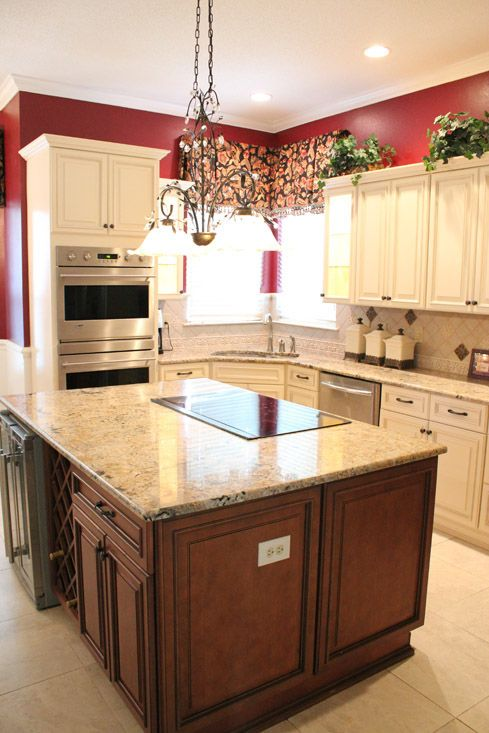This kitchen received contrasting kitchen cabinets from Fabuwood Cabinetry  in Ivory and Cinnamon finishes after water damage. Cinnamon Glaze Forevermark RTA cabinets with Tan Brown granite and