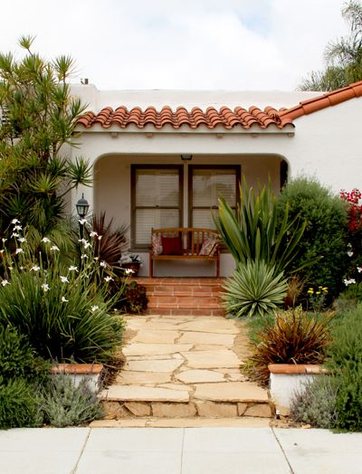 Front yards spanish and the window on pinterest for Mediterranean front porch designs