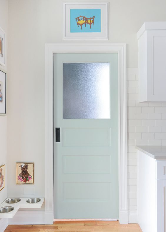 Kitchen pocket door color:  Swept Away by Benjamin Moore.  Cute little doggie corner.: