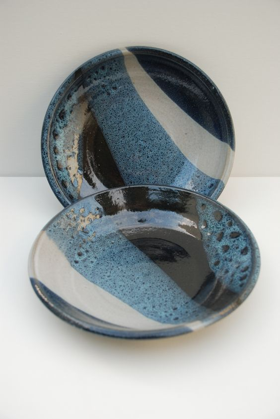 Liz Comay - Ceramic plates, layering black and white and blue