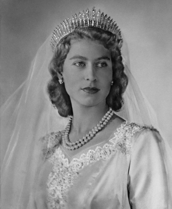 Princess Elizabeth in Her wedding dress, November 1947. The genes run strong in that family- this looks like Prince Will in a dress. lol