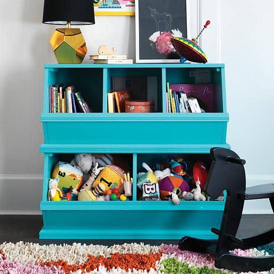 The Land of Nod's most popular storage item comes in a variety of rich colors.  Vegetable bins were the inspiration for these practical toy, book and game storage units.