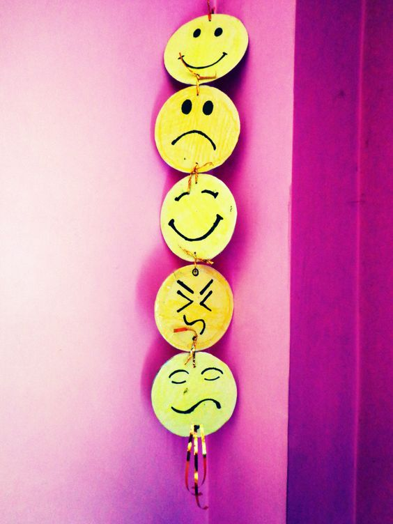 This wall hanging smiley showpiece is made by waste disks for Wall hanging from waste