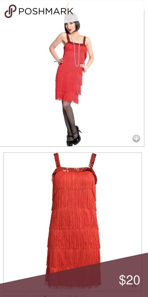 Red flapper dress Still in its original package- never worn!!!.Fyi it only includes the dresss- standard size. Dresses