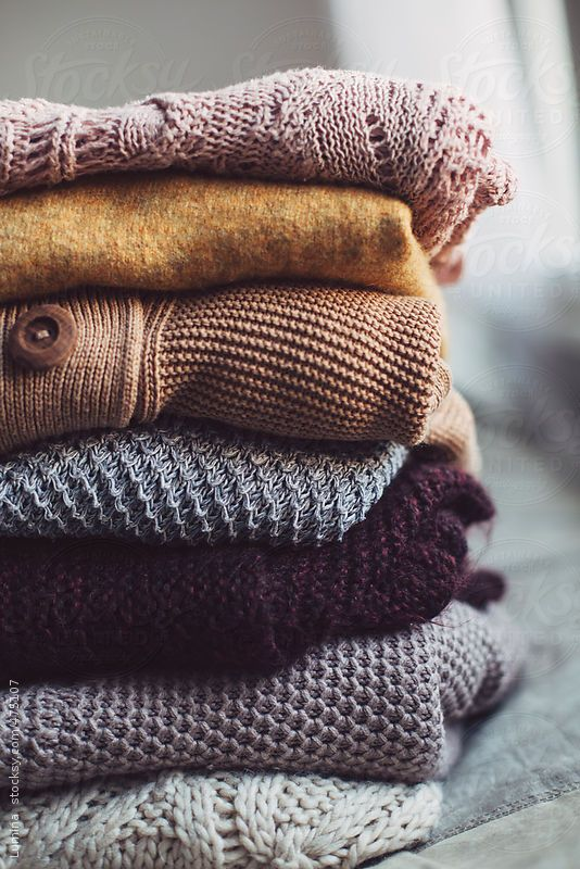 Warm winter sweaters piled up.