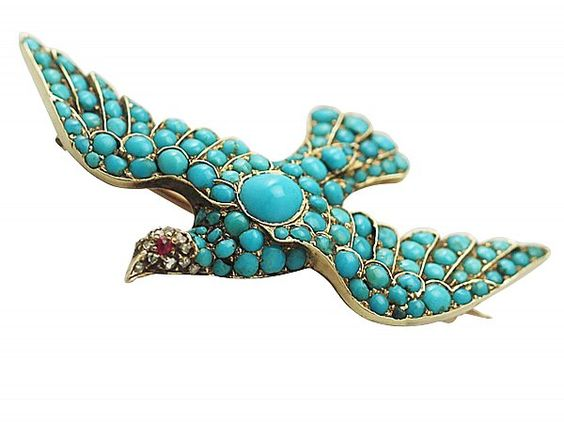 A fine impressive antique Victorian turquoise, ruby and 0.15 carat diamond, 14 carat yellow gold, brooch modelled in the form of a dove. SKU: W9954 Price: GBP £1495.00 #dove #brooch #animal #gold #turquoise #ruby