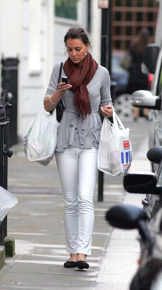 Dated July 3 2007. Kate Middleton proves she not too posh to shop as she pictured leaving Tesco in SW London: