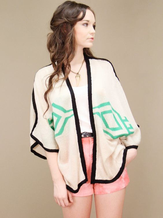 oversized open-front cream cardigan with green tribal print