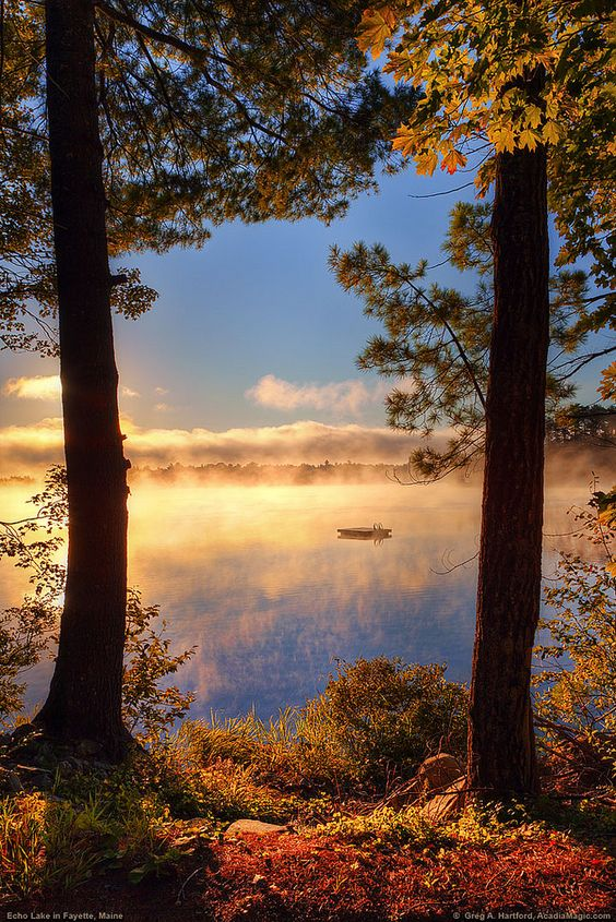 The sunrise on the lake, and morning mist comes together on Echo Lake in Fayette, Maine, part of Kennebec County.