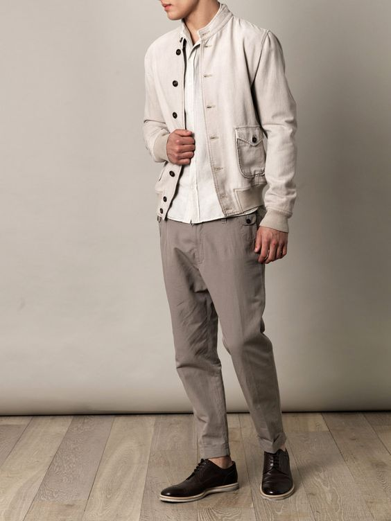 Beige cotton bomber jacket with a high-neck collar, ribbed-knit neckline, hem and cuffs. The season's essential bomber jacket takes a step away from its sporting origins with this Dolce & Gabbana style – opting instead for a more polished, utilitarian vibe more suited to classic wardrobes.  Shown here with Dolce & Gabbana Milano lace-up brogues, Dolce & Gabbana Cropped cotton-linen trousers and Dolce & Gabbana Spread collar linen shirt.: