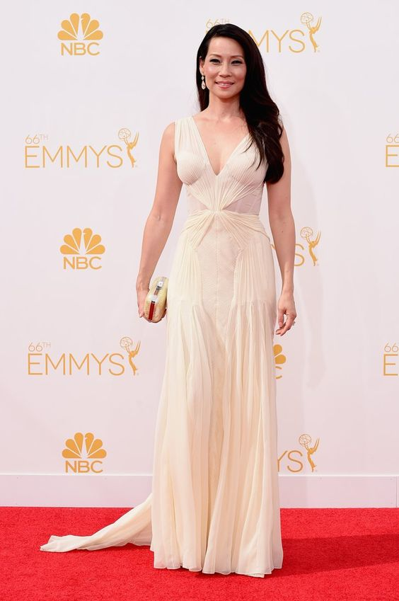 Pin for Later: See Every Dress to Hit the Emmy Awards Red Carpet Lucy Liu Yet another actress to wear white, Lucy Liu paired her Lorraine Schwartz jewels with a deep-v gown.