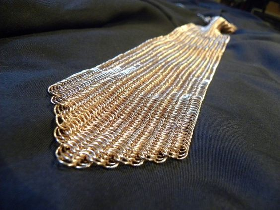 Handmade bronze chainmaille tie...4000 Jump rings! Awesome, Reggie!