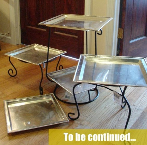 Creative serving table idea - Use plant stands to hold platters and trays to present food at different heights