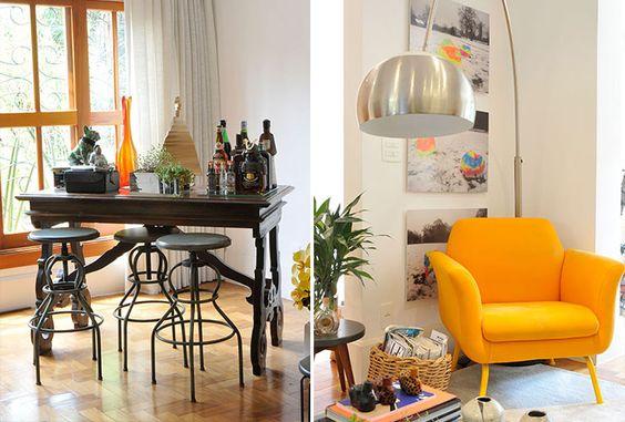 Bar improvisado com banquetas. Poltrona amarela com luminária moderna.