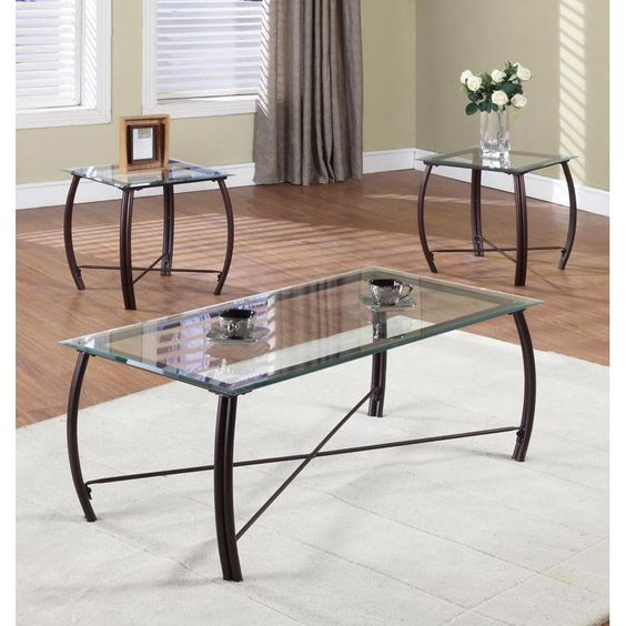 Modernize your living room with this contemporary glass cocktail table that is paired with two end tables. Sturdy metallic bases, gracefully curved legs, and beveled glass tabletops are the main features that give the set a classy look.