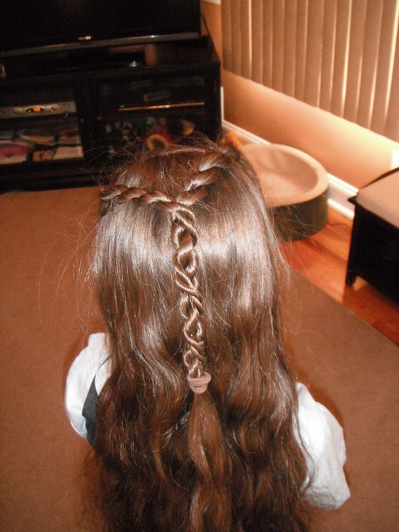 My first try at putting a twist in Bella's hair