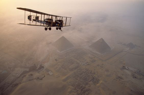 In the light of early morning, the Vimy circles the pyramids at Giza on a dawn tour, May 1995.