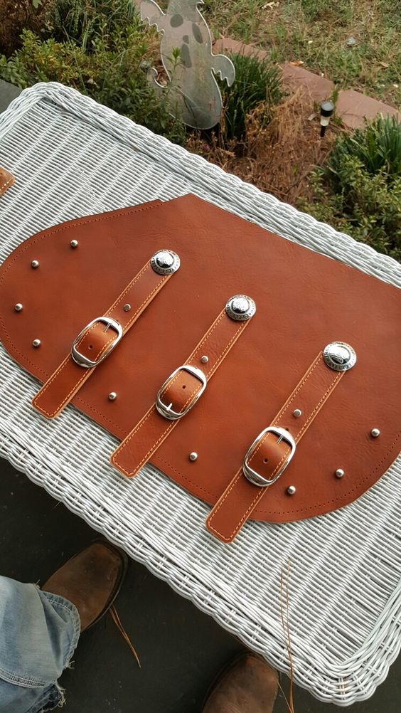 the beginning of new leather on some indian motorcycle saddle bags