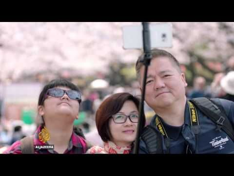 Japan looks to tourism to blossom its economy - YouTube