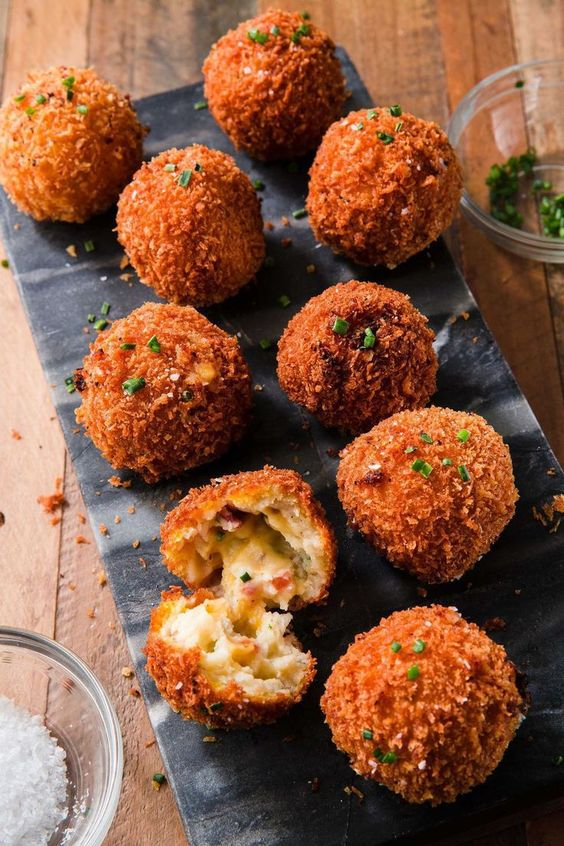 Mashed potatoes that you can eat with YOUR HANDS! Click through to get the recipe for Fried Mashed Potato Balls and to see more easy mashed potatoes recipes for Thanksgiving! #mashedpotatorecipes #bestmashedpotatoesrecipe #mashedpotatoesrecipehomemade #thanksgivingrecipes