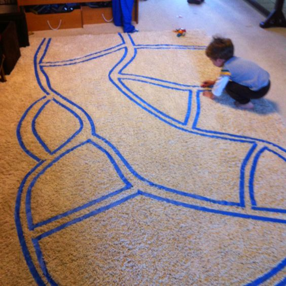 "Rainy day race track. Use painters tape on any surface to make a ""road"" and  it's easily changeable/ removable to make different courses"