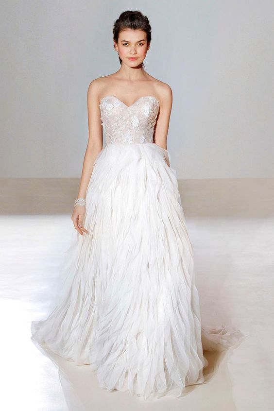 Speaking of being allergic to feathers (it happens!), the 3654 from Lazaro is the perfect faux-feather option. The layered skirt is expertly cut to give the appearance of feathers, but without any of the tickly side-effects. We have fallen in love with the delicate bodice detail too.
