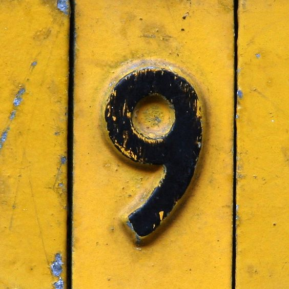 Even an old vintage number nine on an even older yellow painted gate can still pop.